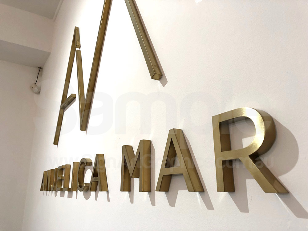 Fabricated-Brush-gold-stainless-steel-letters-20mm-thick-reception-wall-sign