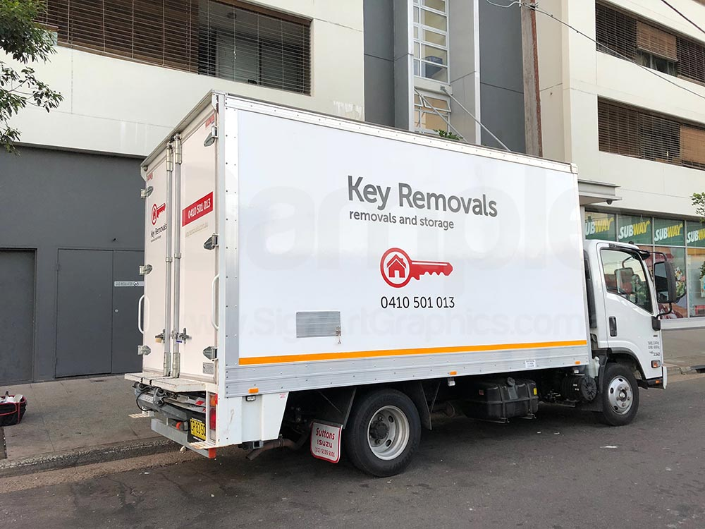Truck-signage-red-colour-vinyl-lettering